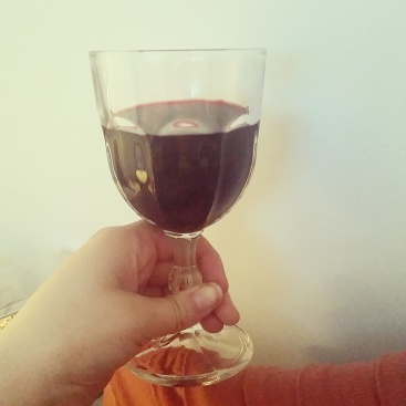 A deep red wine in a thick glass goblet