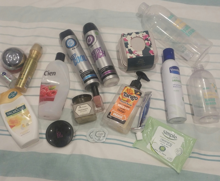 Candles, makeup, skincare and more laid out