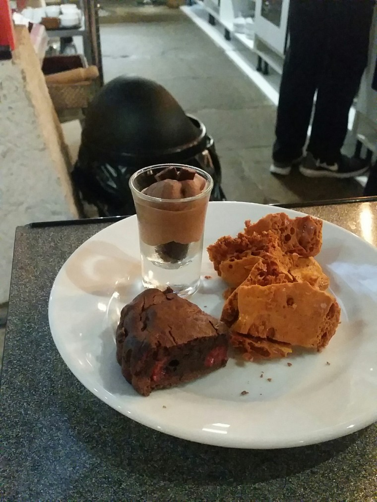 The desserts, two heavily involving dark chocolate, make up a plate