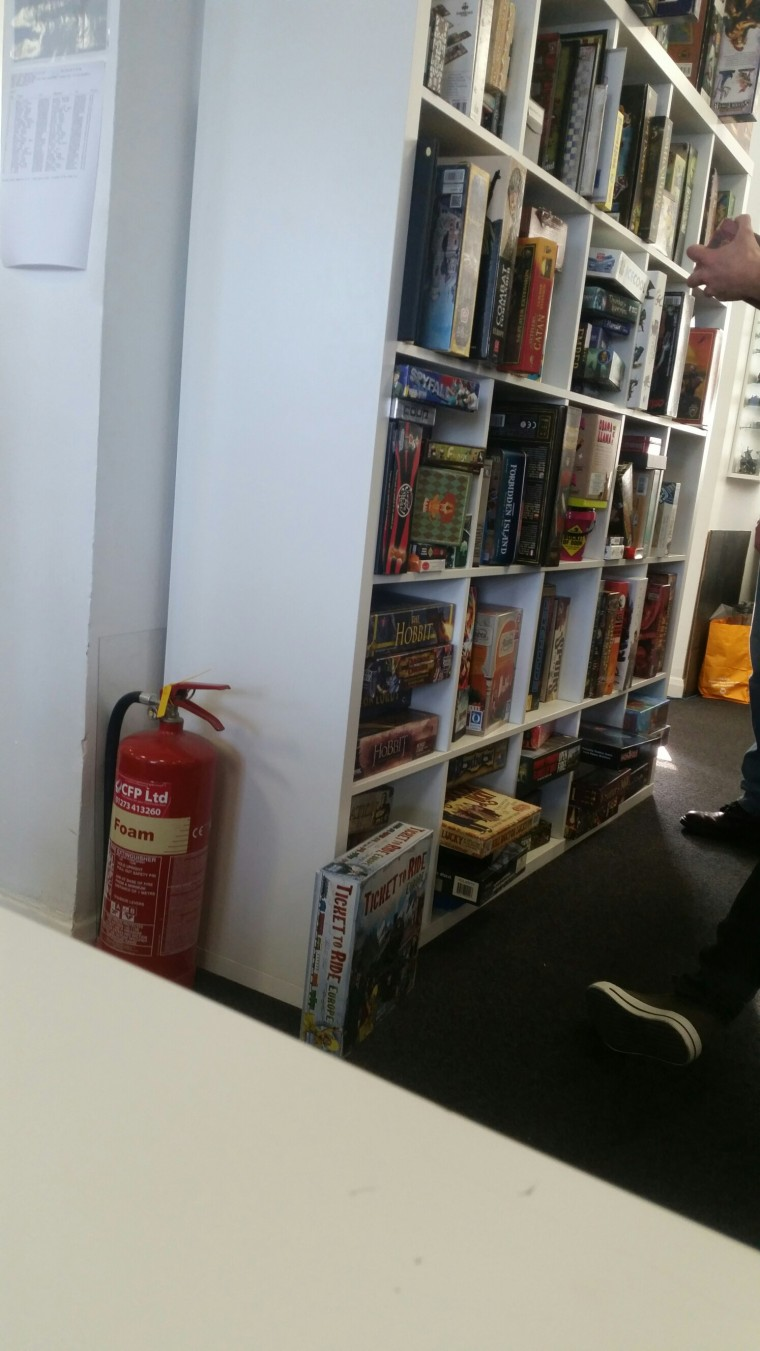 The bookcase of boardgames in the cafe to choose from