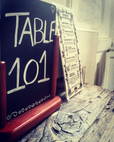 Table 101 on a chalkboard in a restaurant