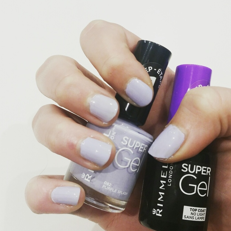 A lilac purple nail varnish coats the nail with step one and two bottles being held to show the colour fully