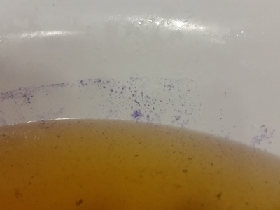 Purple stain on bath with orange water from Lush Lava Lamp bath bomb