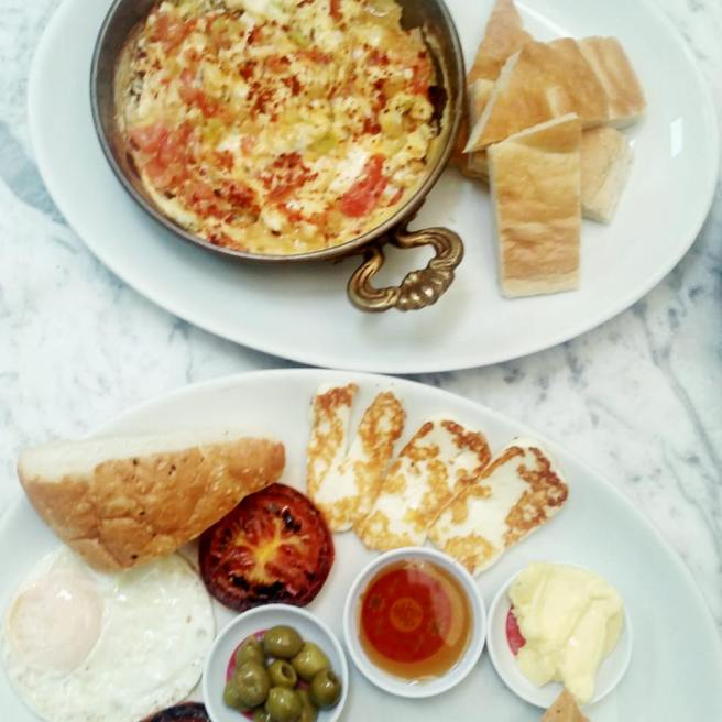 Menemen and Turkish breakfast on white table at Nick's Cafe Bromley