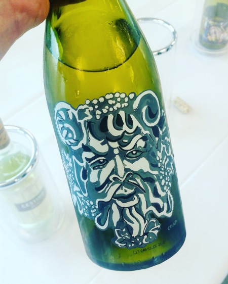 Craft beer style label on a white wine bottle
