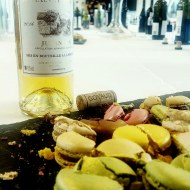 A small bottle of wine with colourful bites