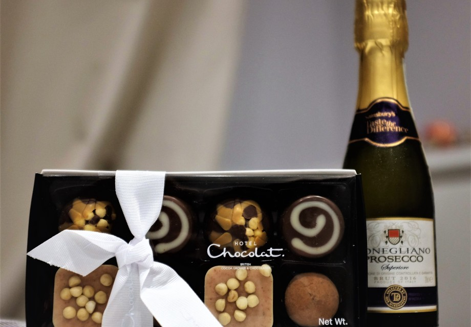 Girly pick me up gift of chocolates and prosecco from a friend