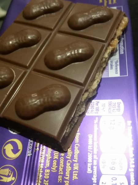 Pattern on top of Dairy Milk big taste peanut caramel crisp chocolate bar