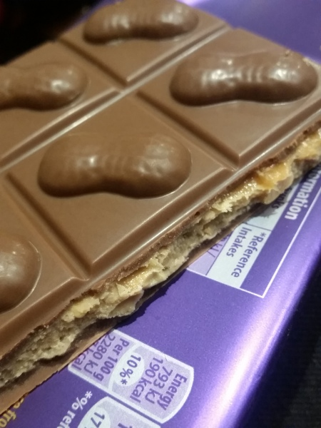 Dairy Milk big taste peanut caramel crisp chocolate bar square and interior