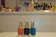 Three nail varnishs, pink, purple and blue by L'Oreal