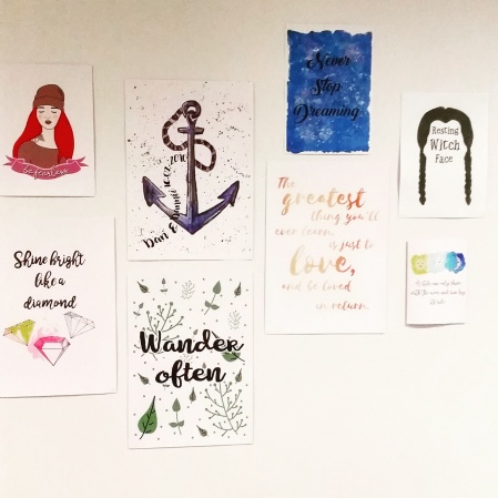 Artwork and quotes on a motivational wall