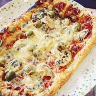 Puff pastry, tomato, mushroom, olive and cheese pizza