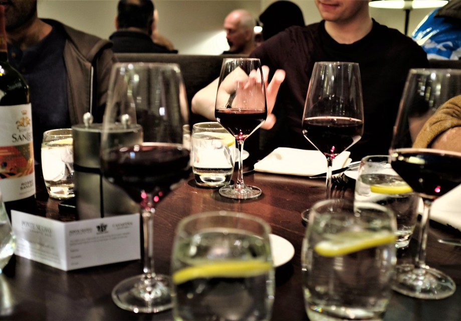 Red wine in glasses on table