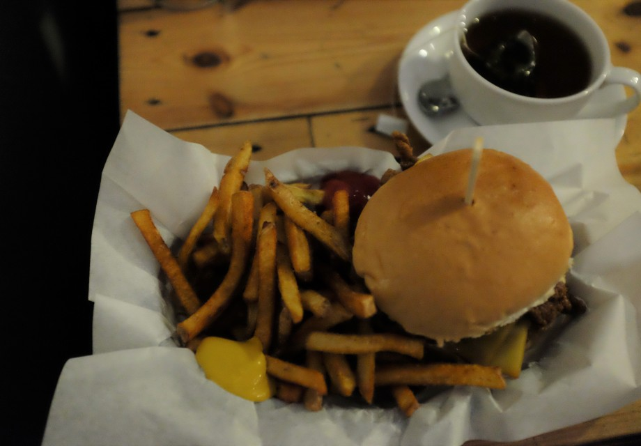 Burger and chips with a cup of tea