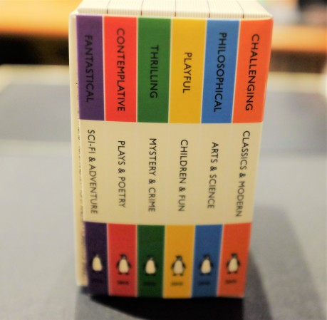 Various book covers for each category colour