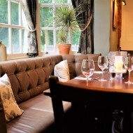 Table, chairs and window at The Fox