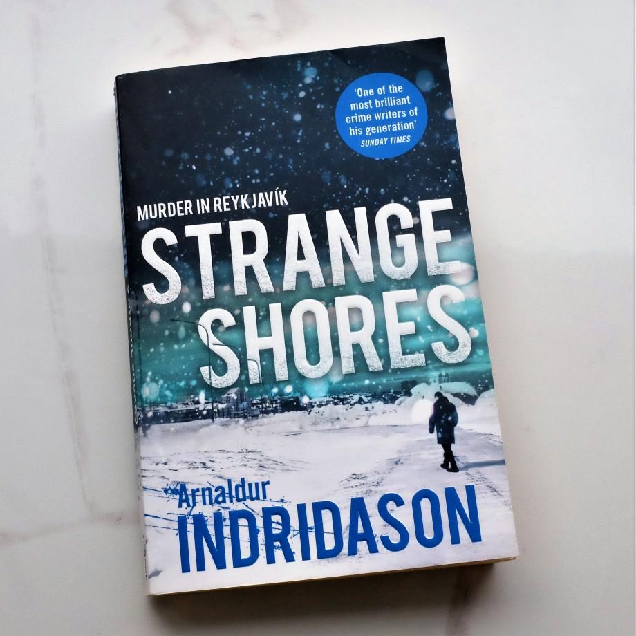 paperback copy of Strange Shores